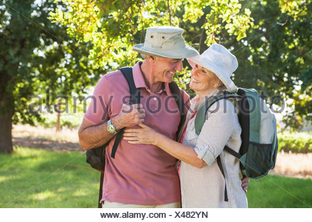 Senior Couple Hiking In Countryside - Stock Photo