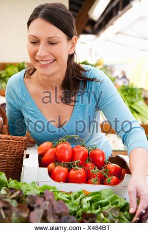 Woman Shopping fresh Vegetables - Stock Photo