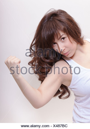 Attractive woman making a fist - Stock Photo