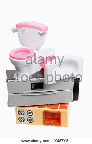 Stack of Plastic Toys on White Background - Stock Photo