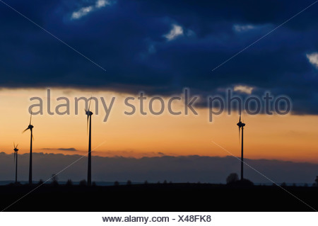 Germany, Saxony, View of wind turbine against cloudy sky - Stock Photo