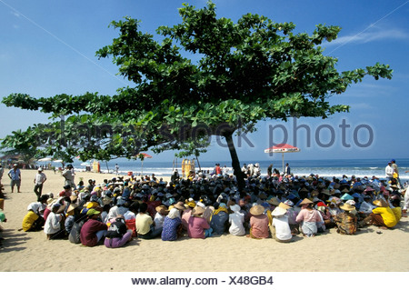 Traders Hold Meeting In The Shade In A Tree On Beach - Stock Photo