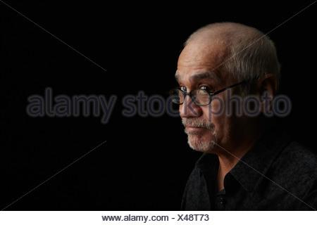Smiling older man wearing eyeglasses - Stock Photo