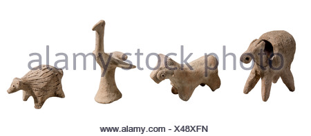 four Terracotta animal figurines 2000 BCE from left to right Donkey, Horse, bird and hedgehog - Stock Photo
