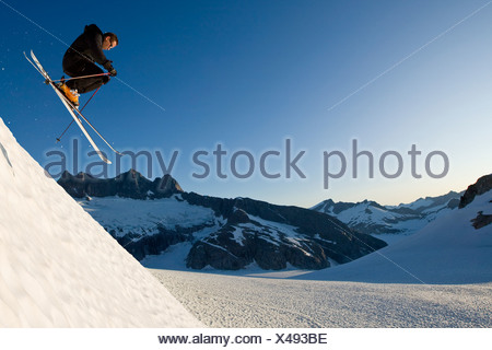 Alpine skier enjoying the wide open and uncrowded skiing in the Juneau area, Mendenhall Glacier, Southeast Alaska - Stock Photo
