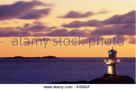 Scandinavia, Sweden, Bohuslan, Lighthouse at dusk - Stock Photo