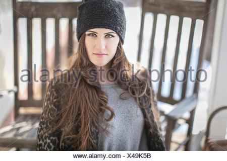 Portrait of young woman wearing knit hat - Stock Photo