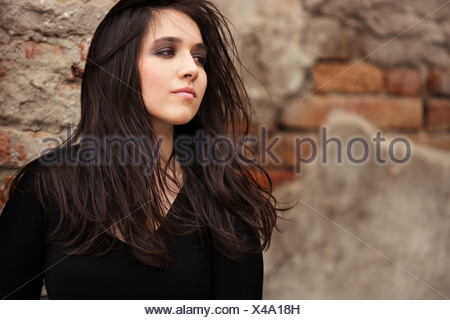 Young woman with wind in her hair, Zagreb, Croatia, Europe - Stock Photo