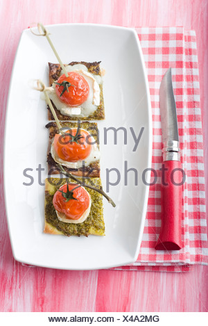 Asparagus and goat cheese pizzetta - Stock Photo