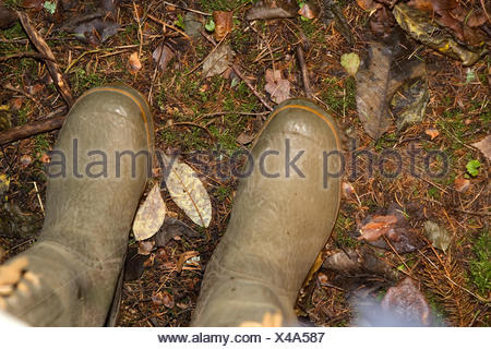 A pair of boots on the ground, Sweden. - Stock Photo