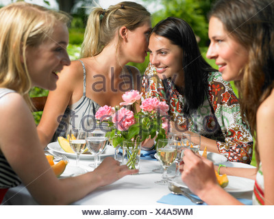 Girlfriends having lunch outdoors - Stock Photo