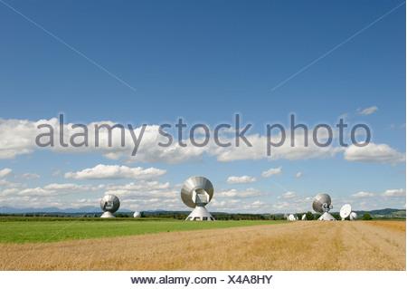 Earth station antennas, radio telescope, near Raisting, Upper Bavaria, Bavaria, Germany, Europe - Stock Photo