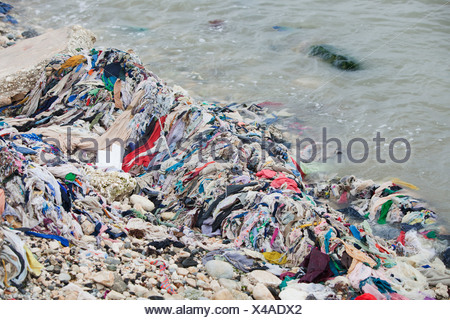 garbage on the beach along the water's edge after haiti's earthquake; port-au-prince, haiti - Stock Photo