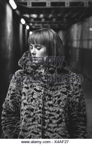 Beautiful Young Woman Wearing Fur Coat Standing In Subway - Stock Photo