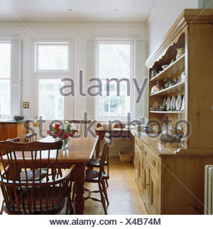White Flooring In Large Dining And Living Room In Open