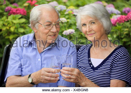 senior couple at drinking - Stock Photo