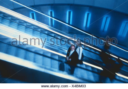 Airport terminals, detail, escalator, travellers, inside, airport, Dusseldorf, manager, upward, stairs, movably, personal transport, promotion, business people, go away, arrival - Stock Photo