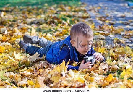 Small boy with a retro slr camera - Stock Photo