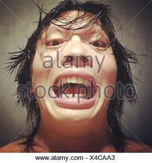 Close-Up Portrait Of Man Making Face - Stock Photo