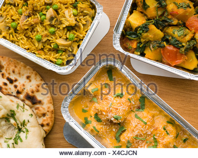 Selection Indian Take Away Dishes In Foil Containers - Stock Photo