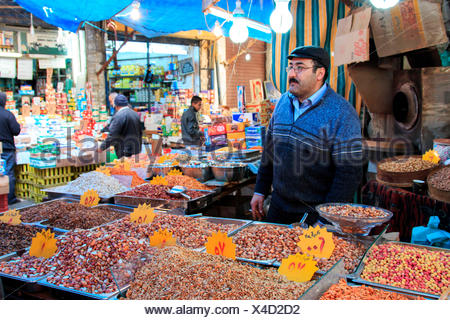 Man selling spices in the downtown market of Amman in Jordan - Stock Photo