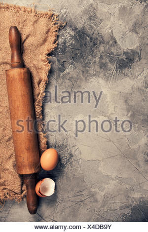 Top view on Old Kitchen cooking utensils on grey stone table - cooking concept - Stock Photo
