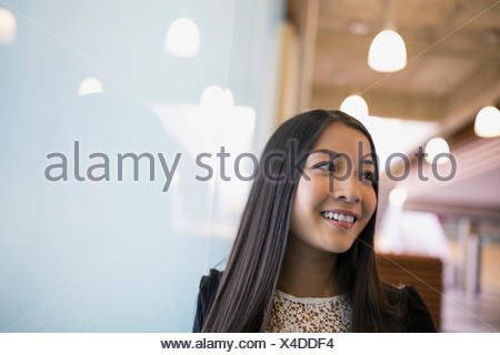 Smiling woman looking away - Stock Photo