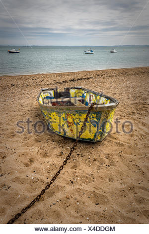 Boat on Shoeburyness beach,Southend-on-Sea,Essex,England,UK - Stock Photo