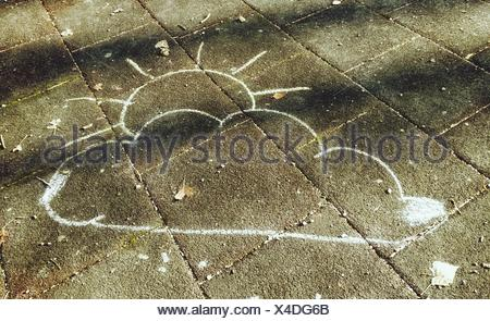Chalk Drawing Of Clouds And Sun Drawn On Footpath - Stock Photo