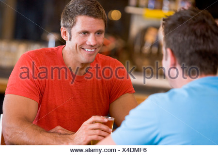 Two men having beer together - Stock Photo
