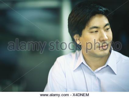 Man in button down shirt - Stock Photo