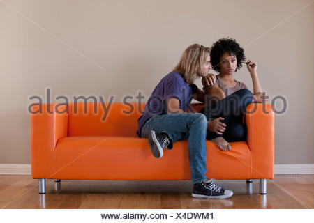 USA, California, Los Angeles, Young couple sitting on sofa - Stock Photo