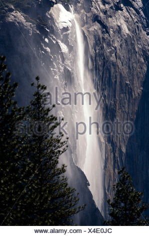 Located on the east side of El Capitan, Horsetail Fall is a seasonal waterfall that flows in the winter and early spring in Yose - Stock Photo