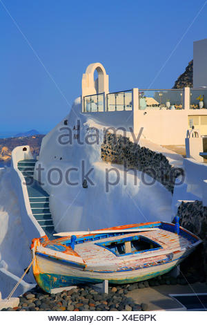 whitewashed wall and old boat, Greece, Cyclades, Santorin, Oia - Stock Photo