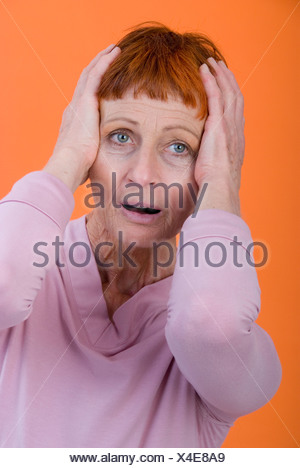 amazed elder woman - Stock Photo