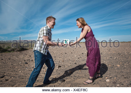 Couple acting out tradition - Stock Photo