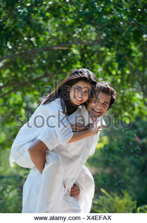 Man carried his girlfriend piggyback in a park, Japanese