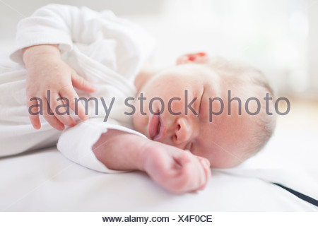 Newborn baby sleeping peacefully - Stock Photo