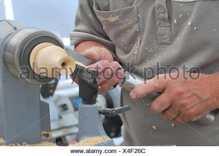 working at small wood lathe - Stock Photo
