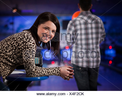 USA, Utah, American Fork, young woman in a bowling club looking at camera - Stock Photo