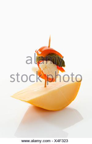 Preserved mixed pickles with cheese on white background - Stock Photo