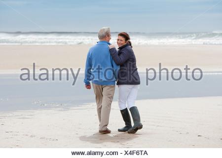 Romantic Mature Couple On Winter Beach Holiday - Stock Photo