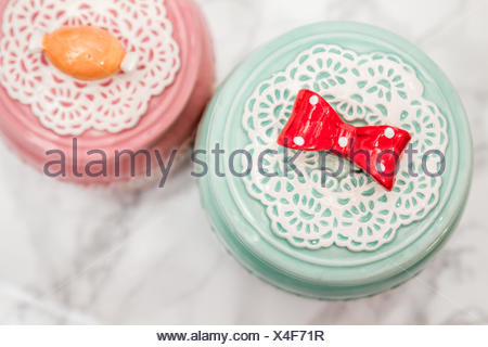 Colorful Ceramic Round Jars with Lace Patterns - Stock Photo