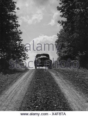 Car moving on country road - Stock Photo