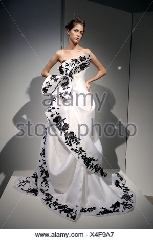 Model Wearing A Strapless White Satin Flolength Evening Dress Black