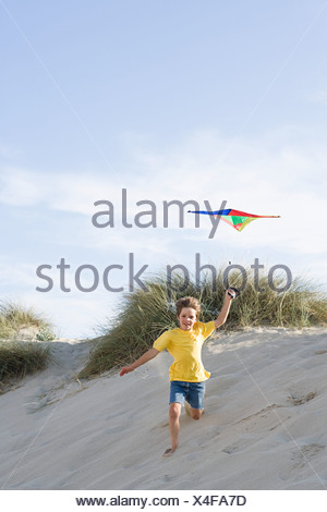 A boy flying a kite - Stock Photo