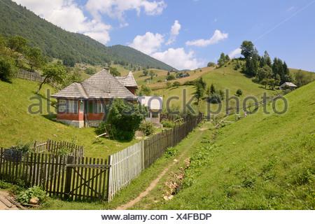 House in a dip, dispersed settlement Magura, Piatra Craiului Mountains, Romania, Europe - Stock Photo