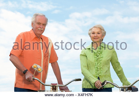 Senior couple with bicycles - Stock Photo
