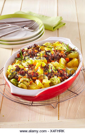 Brussels spout and potato gratin - Stock Photo