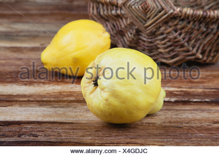 Quince on wooden table, close up - Stock Photo